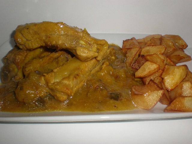 Costillas de cerdo en salsa de cebollas tiernas
