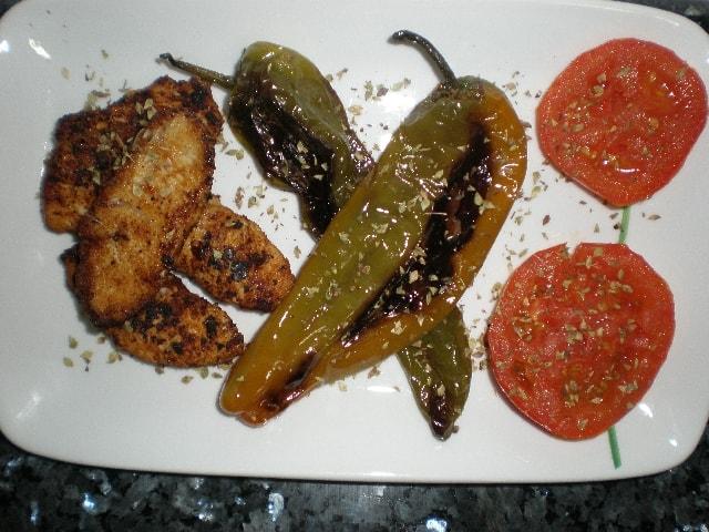 Lomos de pavo con pimientos y tomates