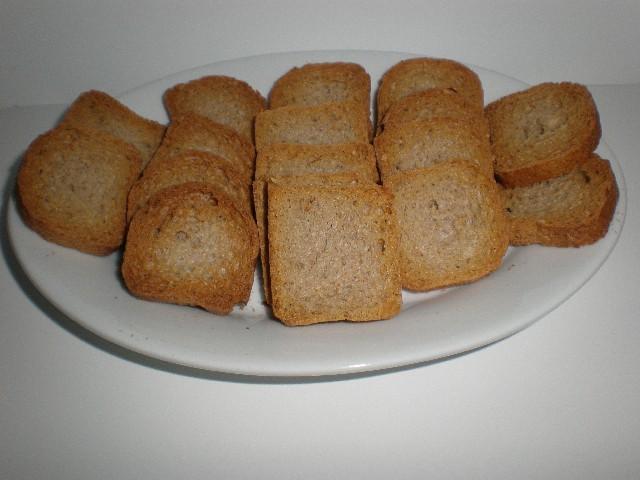 Mini tostadas integrales - Salmón macerado en AOVE