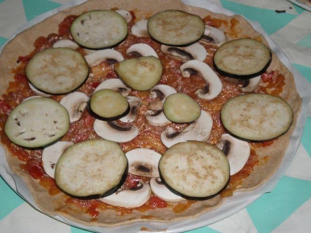 Poner berenjenas - Pizza Santiago